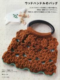 Вязание крючком. Еще одна сумочка, связанная из цветочных элементов.